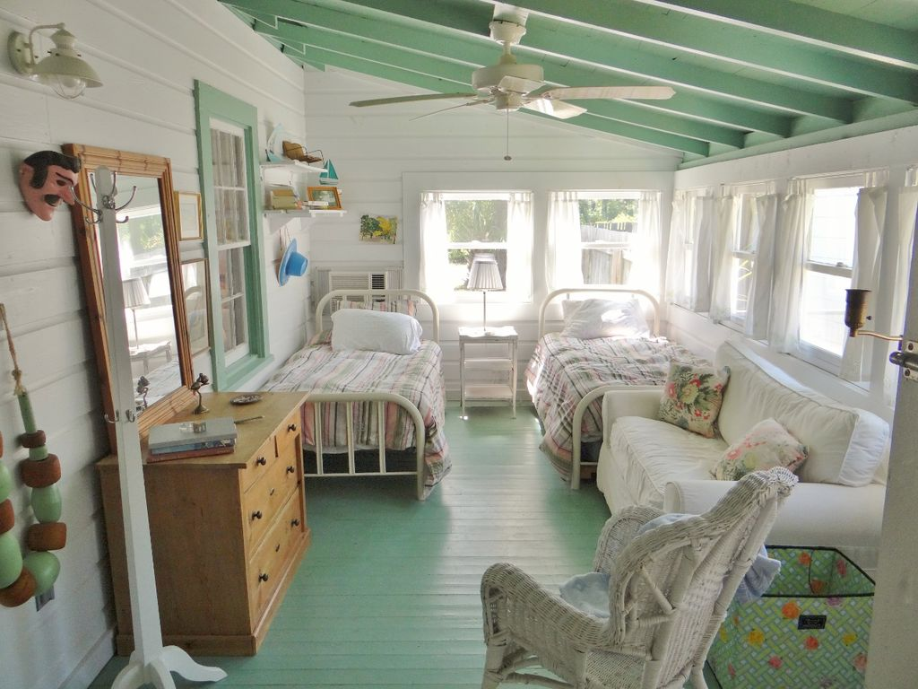 Cottage to rent in Florida - Neptune Rising has this charming sleeping porch