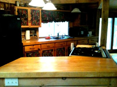 Cooking island in the kitchen that includes the oven and counter surface.