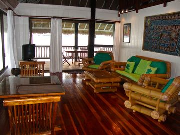 A beautiful Living room facing the lagoon. Flat screen TV too!