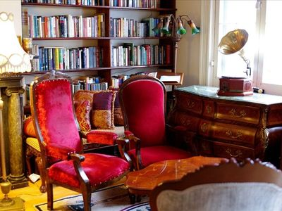 Parlor with balcony, library + sitting area w/plenty of lovely Victorian chairs!