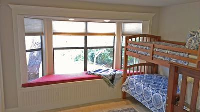 Bedroom 2 has 2 twin over twin bunk beds, sleeps 4 people and has a bay window
