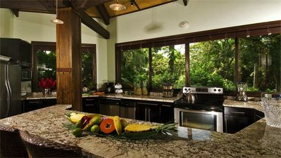 Gourmet kitchen with casual counter eating area