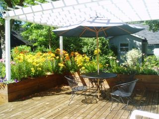 Elk Rapids house photo - Furnished sun deck with pergola