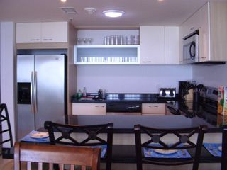Aruba condo photo - Modern kitchen w/stainless steel appliances