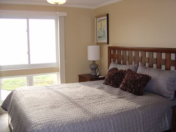 Large King Size Bed in Master Bedroom with views of the bay from window