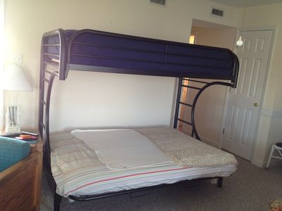 Double bed with twin on top.. Futon during the day.