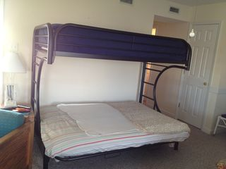 Double bed with twin on top.. Futon during the day. - North Topsail Beach cottage vacation rental photo
