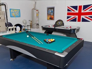 Games Room - Pool Table , Air Hockey and Darts.