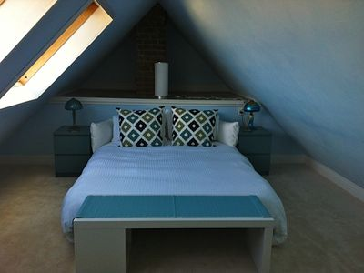loft space made up as bedroom with queen-sized convertible bed
