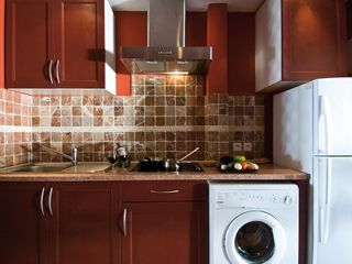 Orient Bay studio photo - The kitchen is fully equipped, there is also a washing machine