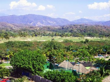 View from the bedroom of the golf course and mountains