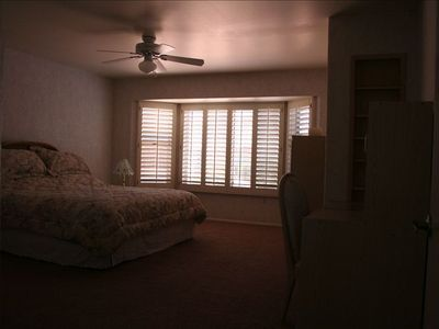 Master Bedroom with King Bed, Desk, Chest, Walk-In Closet, & Dressing Area.