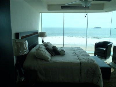 Master Bedroom With All Glass Wall and Ocean Views