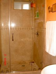 Hollywood house photo - 2nd bathroom w/ frameless shower doors