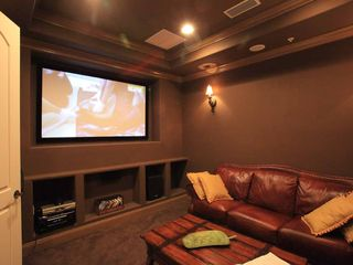 "Flagler Beach condo photo - Comfy Home Theater Room with 84"" Projection TV."