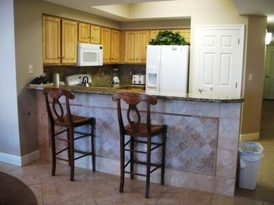 Kitchen Bar with nicely decorated tile walls.