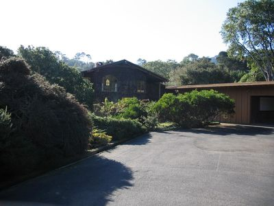 The Cliff House front side, car port and open parking (RV)/large paved area