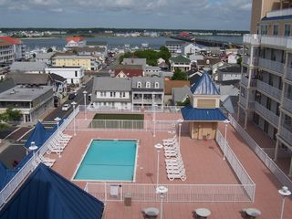 Belmont Towers Ocean City condo photo - Pool, putting green, Bay and Rt. 50 bridge in background