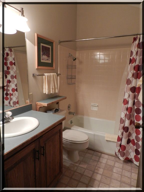 Upstairs full bathroom with bath/shower.