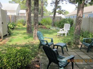 Dennisport cottage photo - Fully fenced back yard...perfect for your dog!