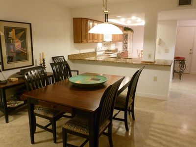 VIEW OF KITCHEN AND DINING ROOM AREA. OPEN FLOOR PLAN, 16 IN PORCELIN TILE FLOOR