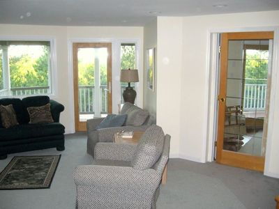 2nd Floor Living Area w/ LCD TV, door to deck; glass slider + door to BR.