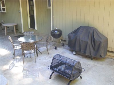 Back courtyard area with BBQs and fire pit.