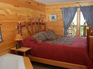Gatlinburg cabin photo - Another one of the four Master Bedrooms with a Jacuzzi for 2 and full bathroom