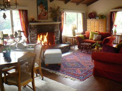 Large living room with fireplace, piano, game table & room for many to gather .