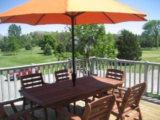 Monticello - Indiana Beach condo photo - Large deck overlooking the course. Gas grill & dining set make for great BBQing.