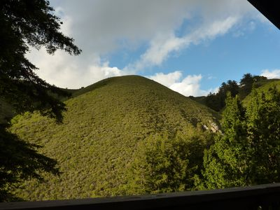 A balcony view of Garrapata Ridge, redwoods and the valley below.