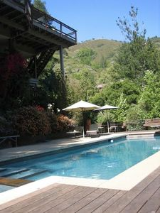 Pool, kitchen deck and hiking ridge above