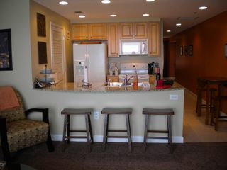 Splash Resort condo photo - The kitchen looks out onto the emerald water of the Gulf of Mexico