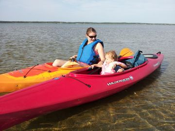 Camden and mom down the road at Katama Bay landing. (use of 2 kayaks is free!)