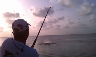 Guest fishing for Tarpon right off the dock