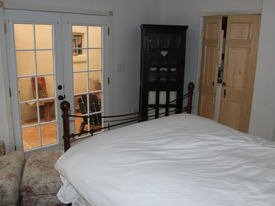 Master Bedroom with doors out to enclosed private patio..
