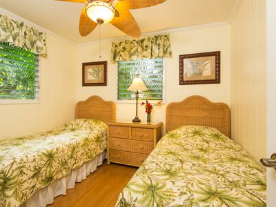 The third bedroom has two twin beds.