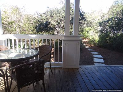 The large porch is nestled in the lush native environment the area is known for.