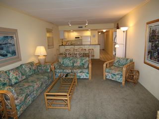 Vacation Homes in Ocean City condo photo - Overall Living room through to Kitchen view shown with wide angle lens