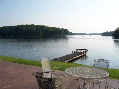 Step out of the den,kitchen onto the patio overlooking Lake. GREAT VIEW