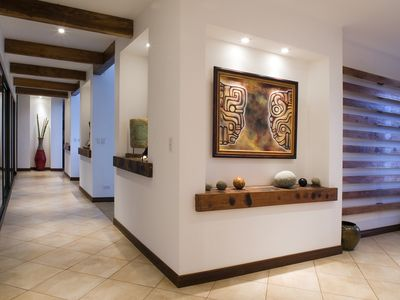 Front door vestibule, teak wall sculpture, maya masks & hallway: art gallery!