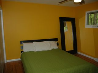 Fennville house photo - Clean, Colorful Master Bed