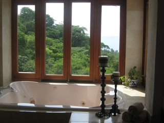 Master suite bathroom with ocean views from shower and jacuzzi tub. - Puerto Vallarta house vacation rental photo