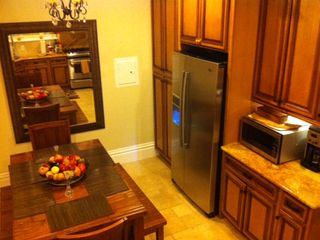 Stainless steel appliances in gourmet kitchen with eating area for 6.