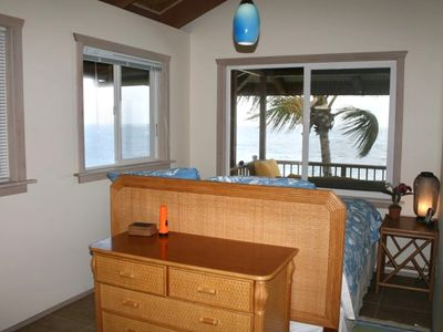 Aqua blue bedroom with ocean view and its own bathroom