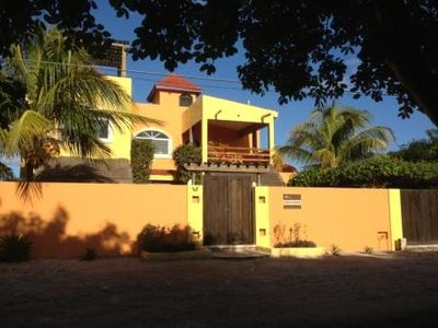 Isla Mujeres villa rental - Street View of Casa Mariposas and its Bright Island Colors & Poolside Coco Palms