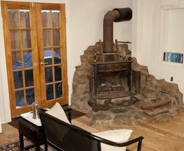 Cozy, original hand laid rock, gas powered fireplace. Add'l heat of course