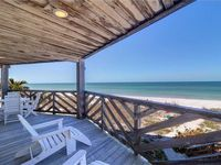 You are directly on the beach! Oceanfront paradise with roomy porch