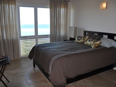 3rd bedroom with queen sized bed and ocean view