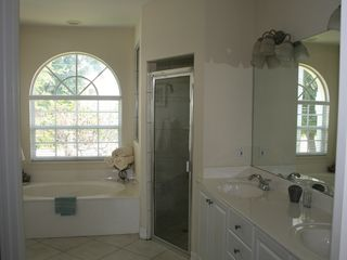 Vacation Homes in Marco Island house photo - Master bath with large shower and garden tub - views of opposite lagoon.